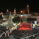 Christian worshipers and tourists celebrate at Manger Square in front of the Church of the Nativity, said to be the birthplace of Jesus, in Bethlehem.