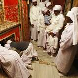 Christians from Nigeria gather in the Grotto of the Church of the Nativity to pray on Christmas Eve.