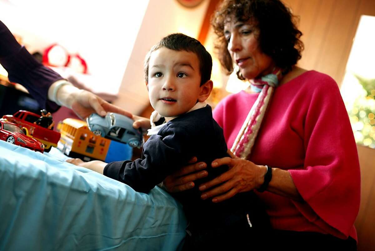 Rolfer Karen S. Price works with patient Ethan Todd, 5, who has cerebral palsy, at her office in Palo Alto, Calif., Friday, December 7, 2012. Rolfing is a process of manual manipulation of the soft tissue which can be helpful in children with muscles stiff from cerebral palsy.