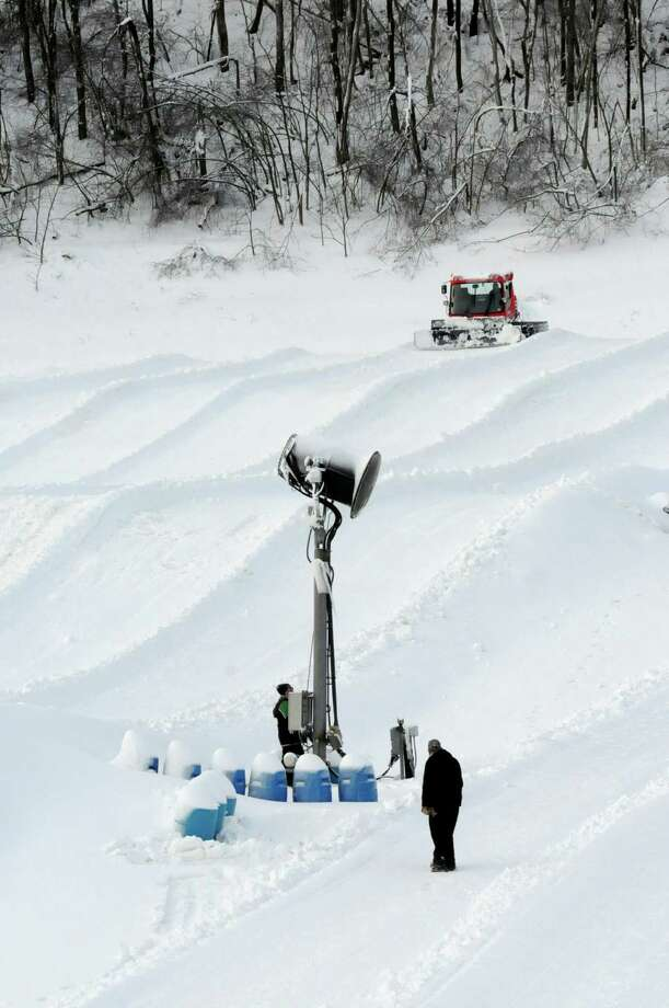 Lanes at Bear Claw Snow Tubing Park at Wisp Resort are groomed Monday, Dec. 24, 2012 by Marshall Lewis, who is driving a Sno Cat vehicle in McHenry, Md. Photo: Steven Bittner, Associated Press / Cumberland Times-News