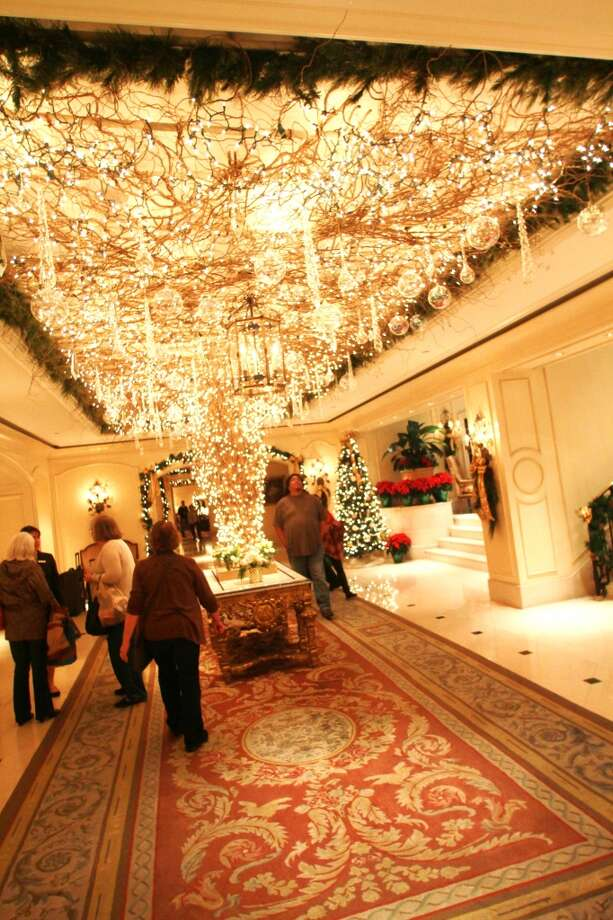 Trees and lights abound in the Ritz-Carlton lobby.
