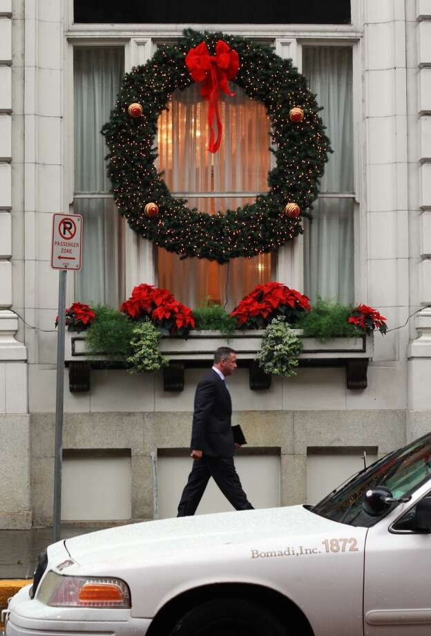 Giant wreaths hang over the sidewalk at the Roosevelt Hotel.