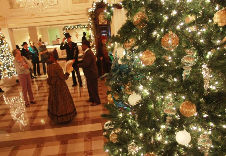 Singers in period garb perform in the lobby of Hotel Monteleone in the French Quarter.