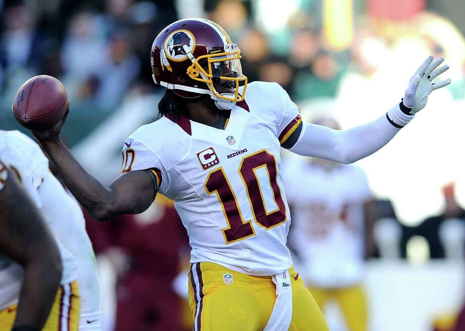Washington Redskins quarterback Robert Griffin III (10) throws a pass in the second half of an NFL football game against the Philadelphia Eagles, Sunday, Dec. 23, 2012, in Philadelphia. (AP Photo/Michael Perez) Photo: Michael Perez, Associated Press / FR168006 AP