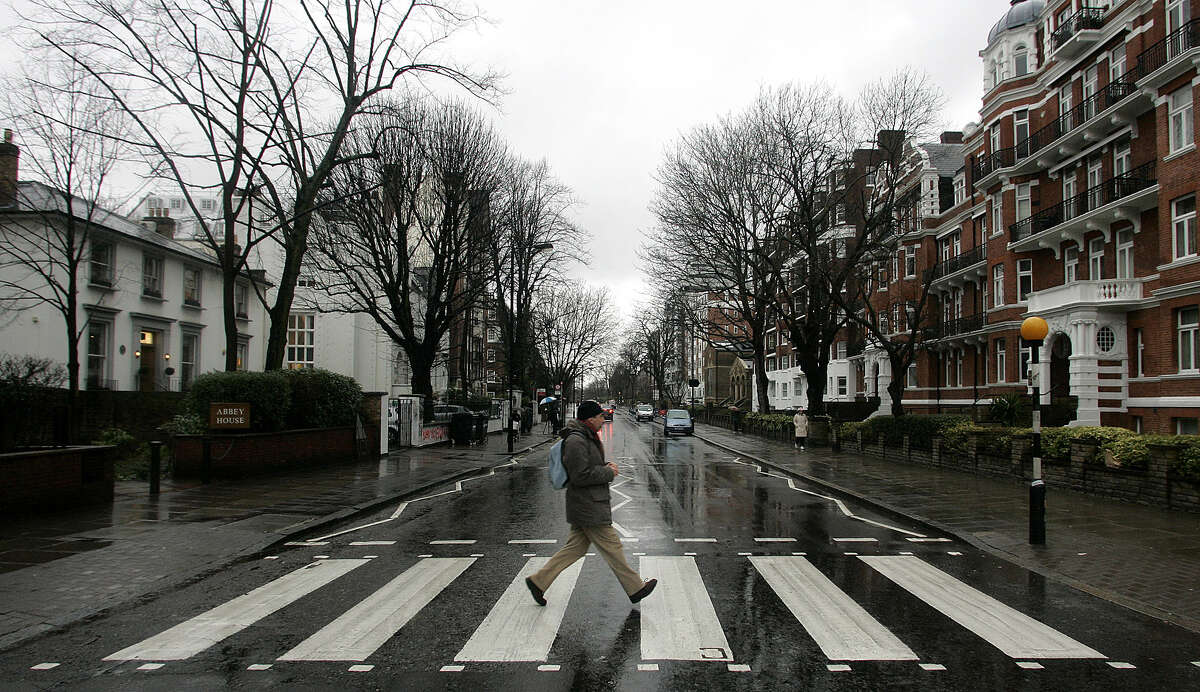 Some tourists looking for this crossing made famous by the Beatles album