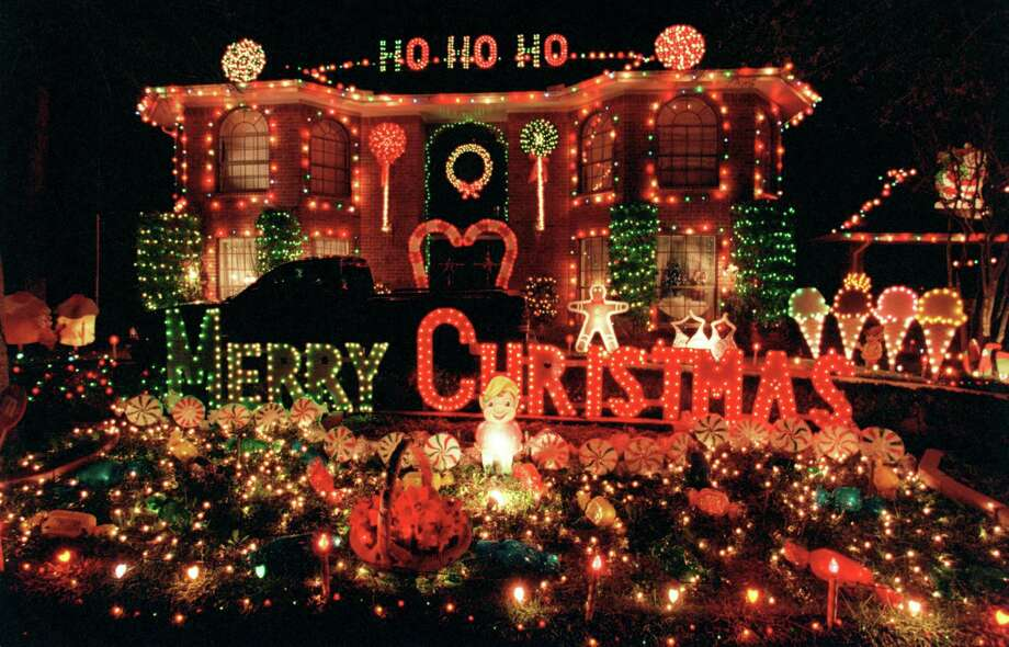 You put up Christmas lights when it is still warm outside. Photo: Karl Stolleis, Staff / Houston Chronicle