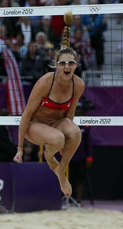 Kerri Walsh Jennings, who didn't know she was pregnant, won gold in beach volleyball. Photo: Petr David Josek, Associated Press