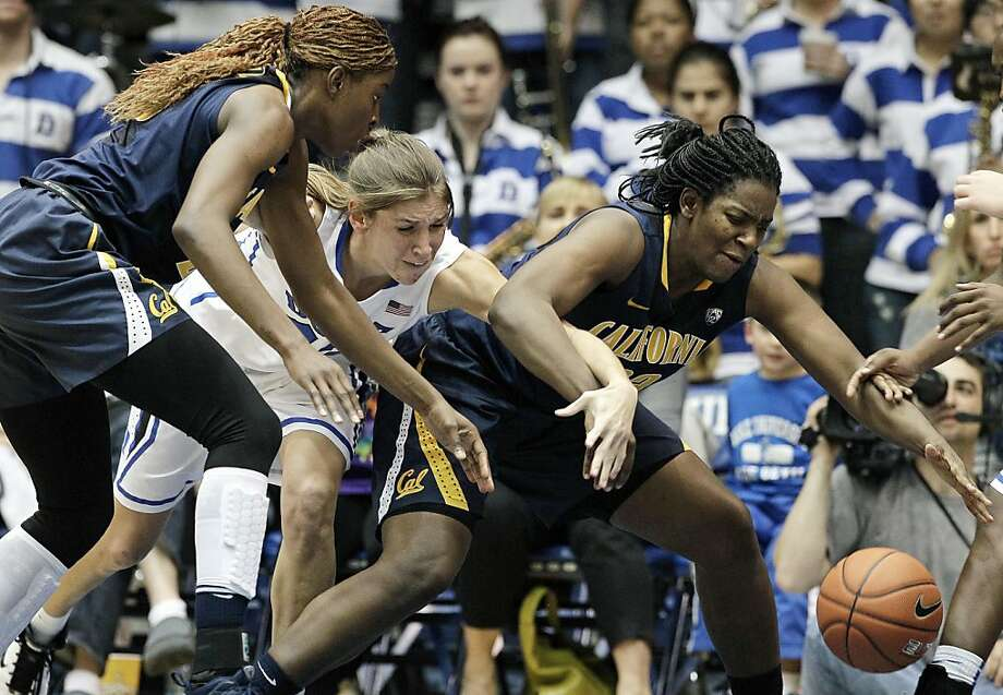 Duke's Allison Vernerey, center, reaches for the loose ball against California's Gennifer Brandon, left, and Talia Caldwell during the second half of an NCAA women's college basketball game in Durham, N.C., Sunday, Dec. 2, 2012. Duke won 77-63. (AP Photo/Gerry Broome) Photo: Gerry Broome, Associated Press