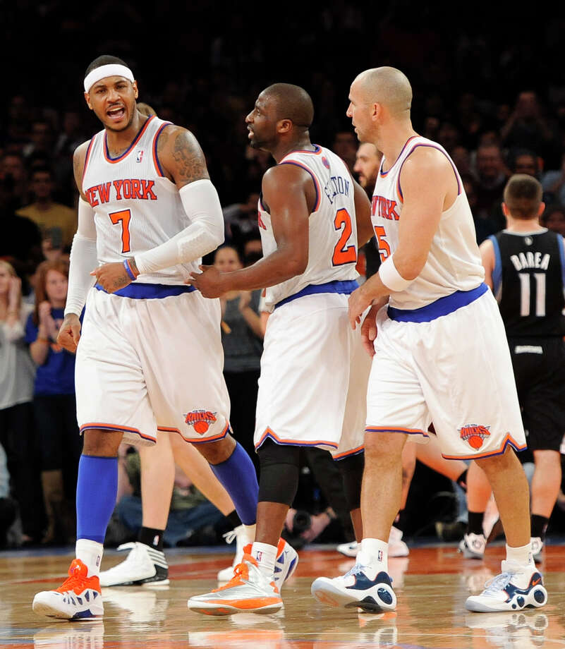 New York Knicks' Carmelo Anthony (7) reacts with  teammates Raymond Felton (2) and Jason Kidd (5) after putting the Knicks in the lead over the Minnesota Timberwolves in the second half of an NBA basketball game on Sunday, Dec., 23, 2012, at Madison Square Garden in New York. The Knicks won 94-91. (AP Photo/Kathy Kmonicek) Photo: Kathy Kmonicek