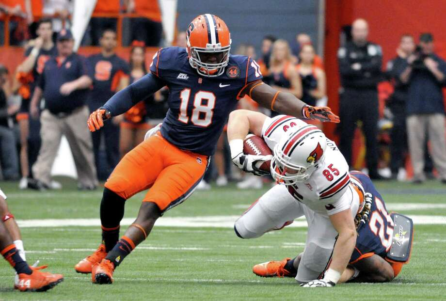 In this Nov. 10, 2012 photo, Syracuse's Siriki Diabate (18) defends against Louisville during an NCAA college football game in Syracuse, N.Y. Diabate is from Africa, as is Syracuse basketball player Baye Moussa Keita. Soccer, once the mainstay of their lives, is now an afterthought at best. (AP Photo/Kevin Rivoli) Photo: Kevin Rivoli