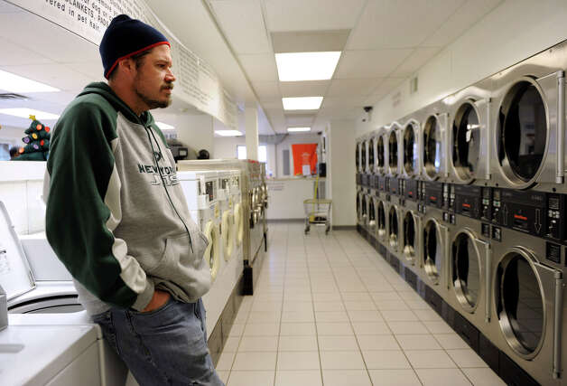 Chris Jaouen, 36, of Monroe, waits for his laundry to dry at PJ's Laundramat in Sandy Hook monday, Dec. 24, 2012. Photo: Carol Kaliff / The News-Times