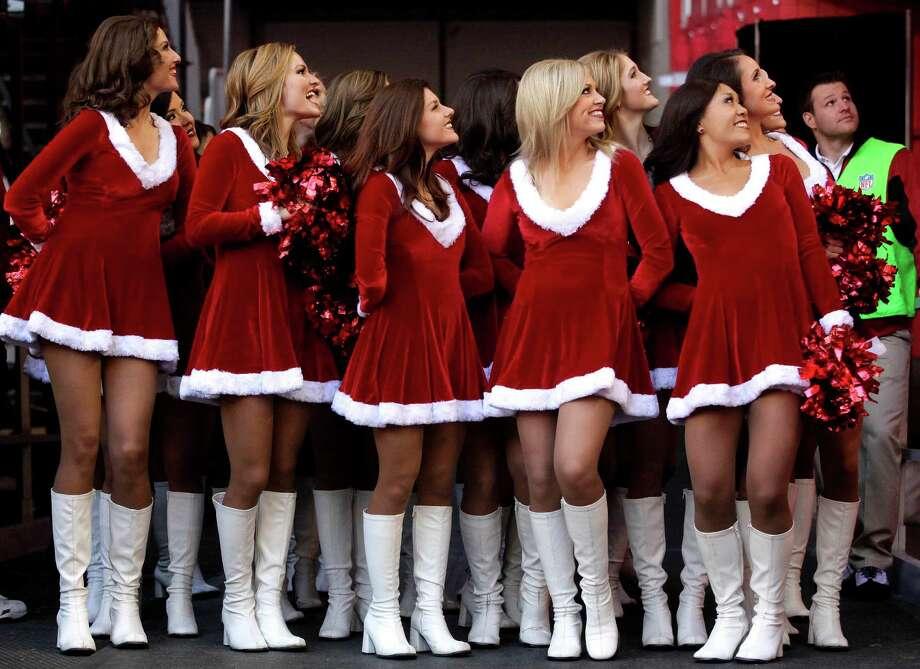 The Arizona Cardinals cheerleaders look in the stands. Photo: AP