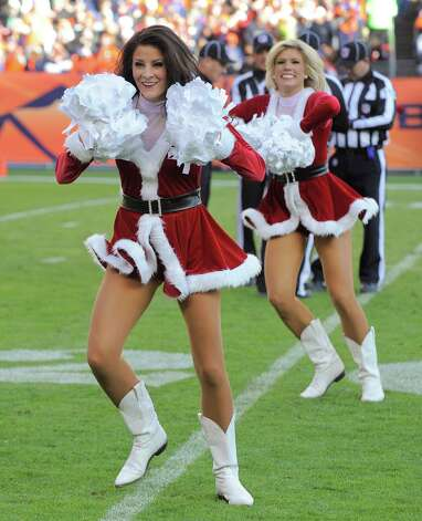 Of course, the Sea Gals' idea wasn't exactly unique. Here, Denver Broncos cheerleaders perform in their Santa outfits during a game against the Cleveland Browns on Sunday in Denver. Photo: AP