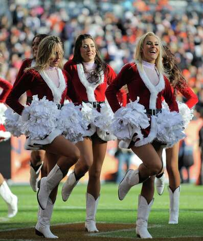Denver Broncos cheerleaders perform in their Santa outfits. Photo: AP
