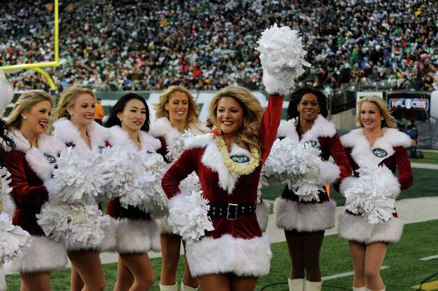 New York Jets cheerleaders dance on the field. Photo: AP