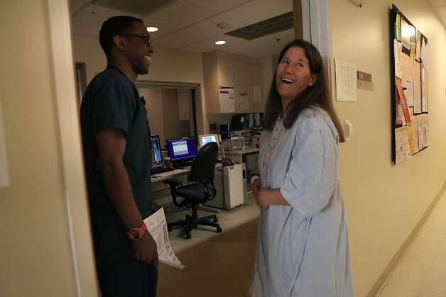 Cheryl Broyles preparing to get an MRI with radiologic technician Alvin Walton in San Francisco, California on Tuesday,  December 11, 2012.  Cheryl has had over sixty MRI's and has survived 12 years of glioblastoma. Photo: Liz Hafalia, The Chronicle