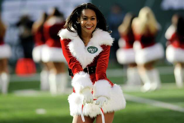 A New York Jets cheerleader performs. Photo: AP