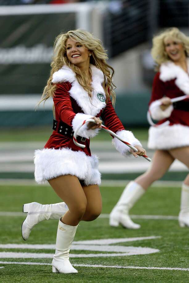 A New York Jets cheerleader performs during the first half of a game against the San Diego Chargers in East Rutherford, N.J. Photo: AP