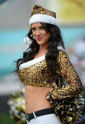 A Jacksonville Jaguars cheerleader performs. Photo: AP