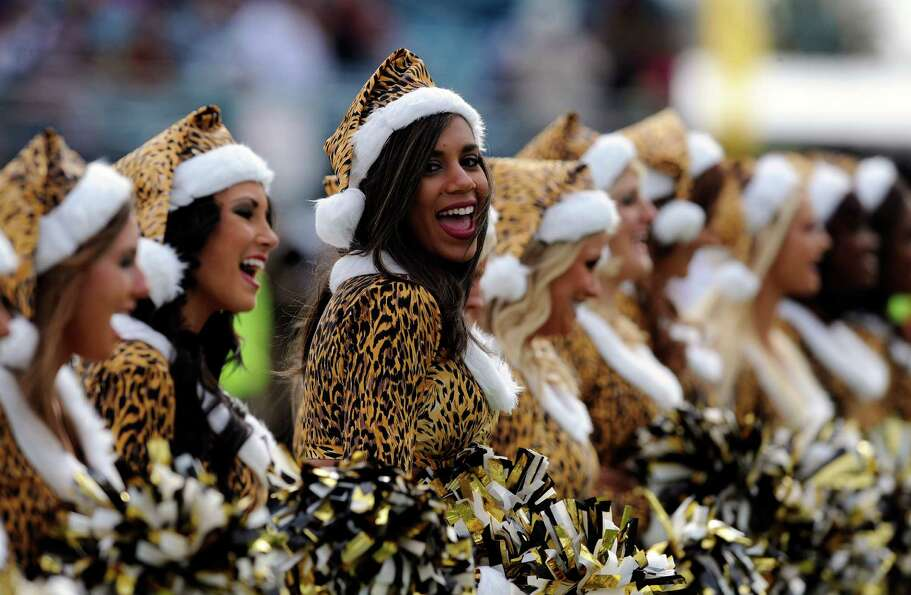 Members of The Roar cheerleading squad for the Jacksonville Jaguars perform on the sidelines.