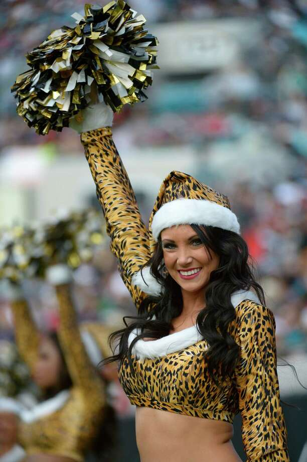 The Jacksonville Jaguars cheerleaders perform during the second half of a game against the New England Patriots in Jacksonville, Fla. Photo: AP