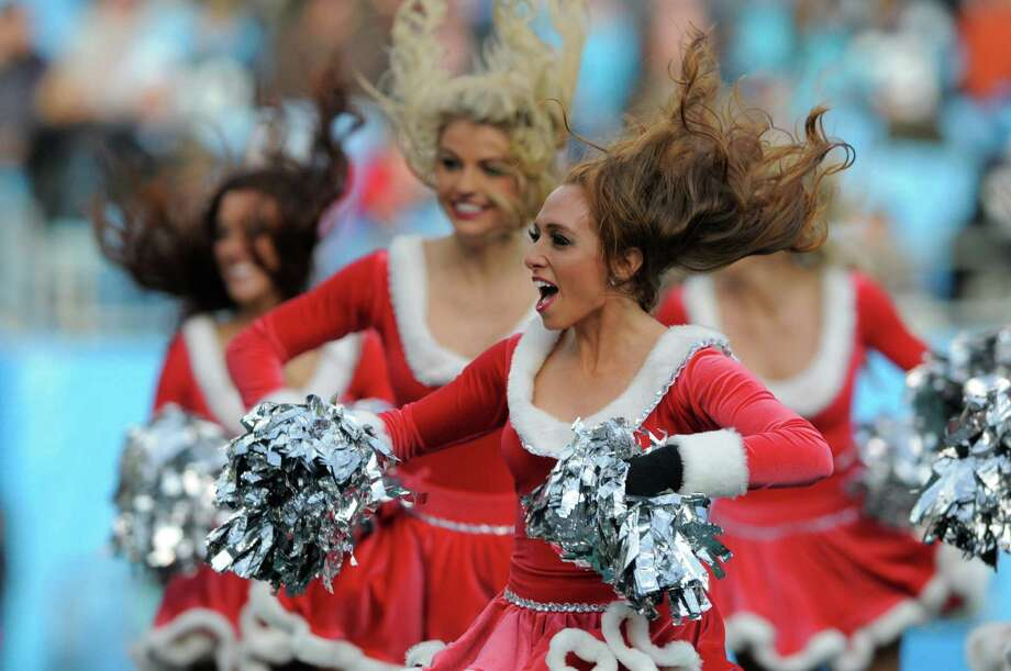 Carolina Panthers cheerleaders perform during the second half of a game against the Oakland Raiders in Charlotte, N.C. Photo: AP