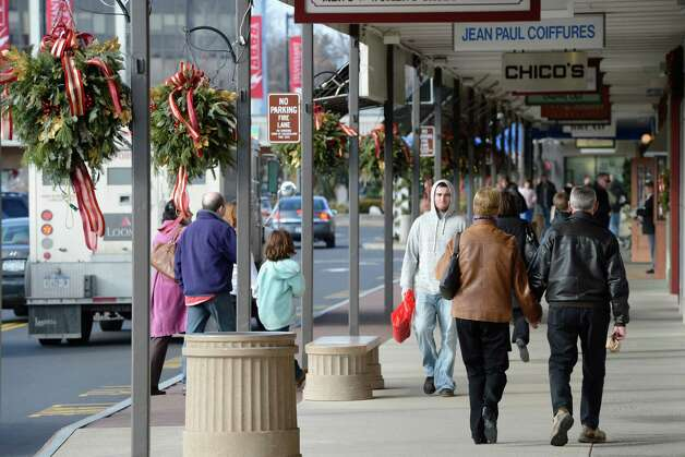 Shoppers are still at it at Stuyvesant Plaza in Albany, N.Y. Dec 24, 2012.     (Skip Dickstein/Times Union) Photo: SKIP DICKSTEIN