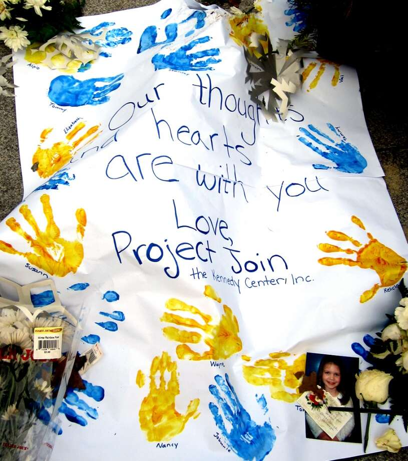 This is one of the messages sent by children to the kids in Sandy Hook, Conn., where 20 students and six school staff members were killed at their elementary school Dec. 14. This picture was taken the evening of Dec. 24, a day when homes across Newtown lit 26 luminaries at 5 p.m. to remember the victims.