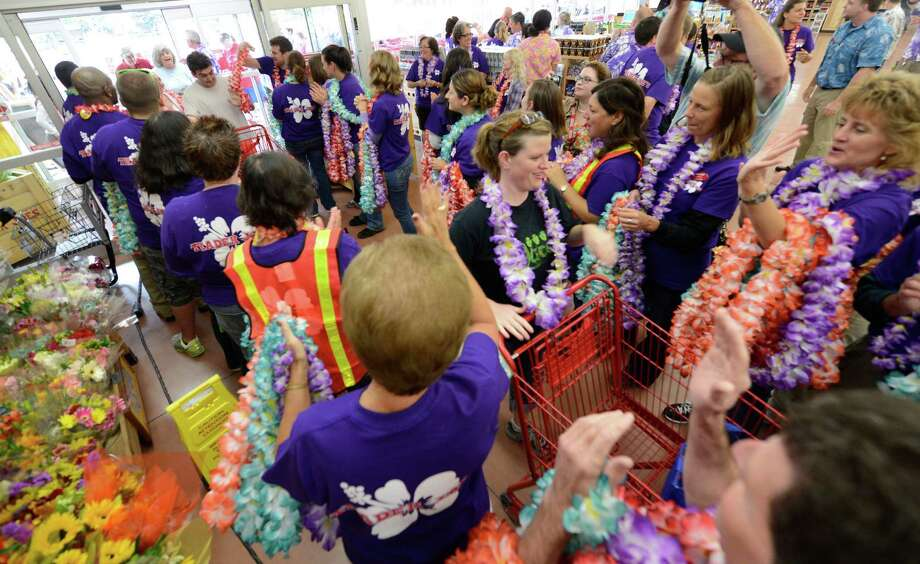 Patrons enter the new Trader Joe's that opened this morning on Wolf Road in Colonie, N.Y. August 3, 2012.     (Skip Dickstein/Times Union) Photo: Skip Dickstein / 00018677A