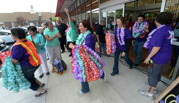 Team members bring out leis for patrons waiting to get in to the new Trader Joe's on Wolf Road in Colonie, N.Y. on August 3, 2012.     (Skip Dickstein/Times Union) Photo: Skip Dickstein / 00018677A