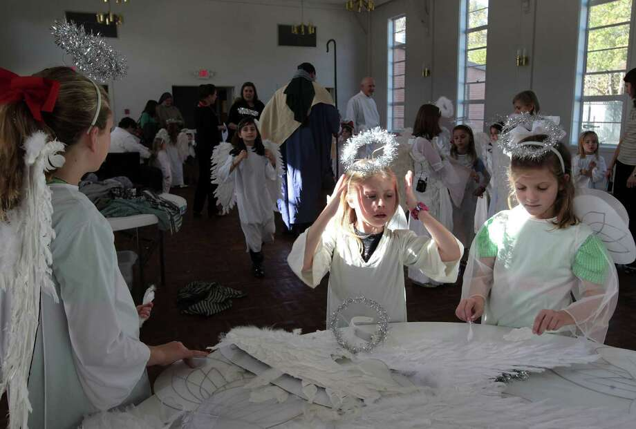 nine-year-old Mary Lacy Rieke left, seven-year-old Lauren Desroches center, and six-year-old Helen Rieke prepare their costumes for the St. Francis Episcopal Church Nativity Pageant and Holy Eucharist Monday, Dec. 24, 2012, in Houston. Photo: James Nielsen, Chronicle / © Houston Chronicle 2012
