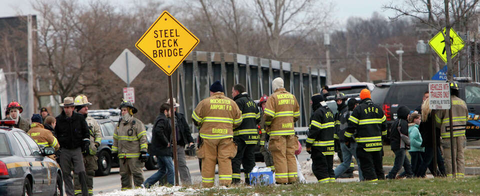 Lake Rd. residents are evacuated from the neighborhood, Monday, Dec. 24, 2012 in Webster, New York.
