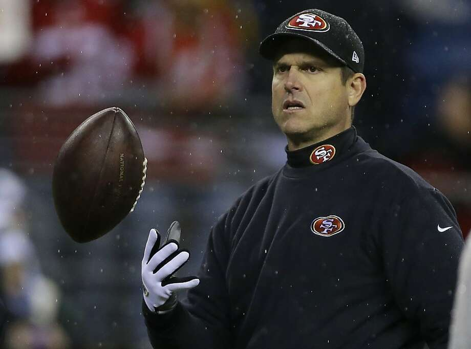 49ers coach Jim Harbaugh was very tight-lipped about Sunday night's loss in Seattle. Photo: Elaine Thompson, Associated Press