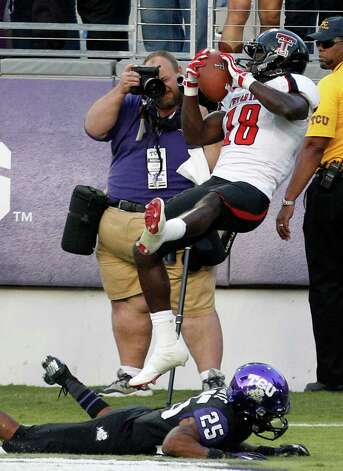 OFFENSEWR: Eric Ward, Texas Tech, 6-0, 204, Jr., Wichita Falls (Rider). Seen here catching a touchdown pass against TCU cornerback Kevin White. Photo: LM Otero, Associated Press / AP