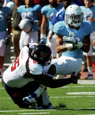 OFFENSEOL: LaAdrian Waddle, Texas Tech, 6-6, 330, Sr., Columbus. Seen here tackling Kansas safety Keeston Terry. Photo: Orlin Wagner, Associated Press / AP