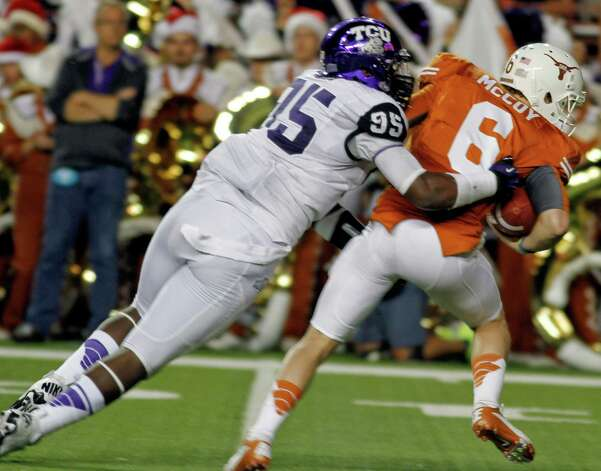 DEFENSEDL: Devonte Fields, TCU, 6-4, 240, Fr., Arlington (Martin). Seen here tackling Texas quarterback Case McCoy. Photo: Jack Plunkett, Associated Press / FR59553 AP
