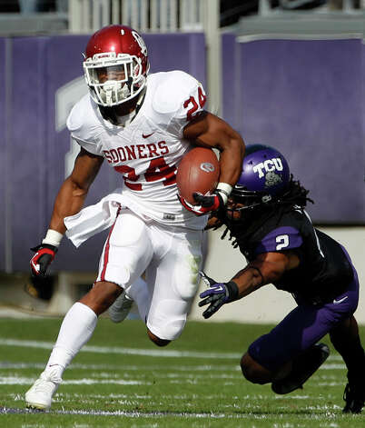 DEFENSEDB: Jason Verrett, TCU, 5-10, 180, Jr., Fairfield, Calif. (Rodriguez /Santa Rosa JC). Seen here attempting to tackle Oklahoma running back Brennan Clay. Photo: Tony Gutierrez, Associated Press / AP