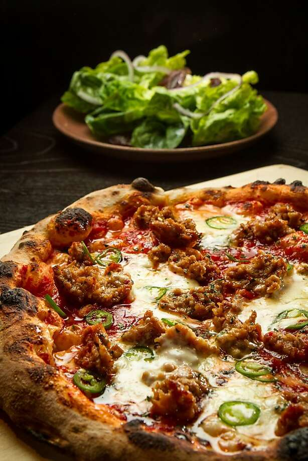 The sausage and honey pizza, with balanced flavors and textures, is a diner favorite. Photo: John Storey, Special To The Chronicle
