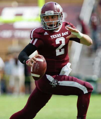 OFFENSE QB: Johnny Manziel, Texas A&M, 6-1, 200, RS-Fr., Kerrville (Tivy) Photo: Eric Kayne, Associated Press / FR170049 AP