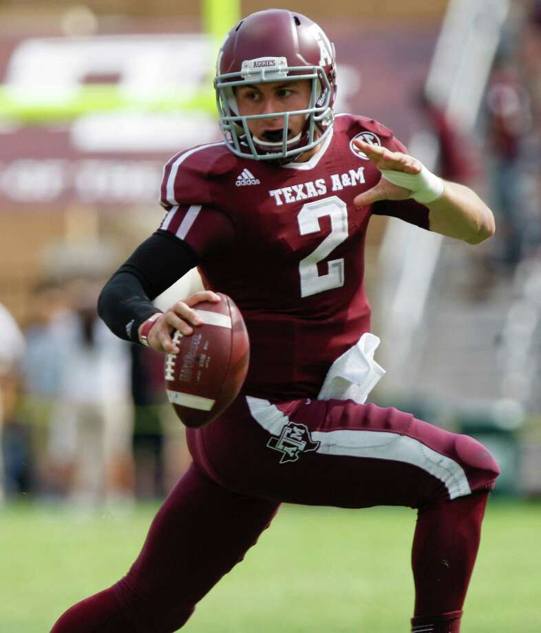 "That guy again: Oklahoma defenders claim they're tired of hearing about Heisman Trophy winner ""Johnny Football."" They'll take any opportunity to aggressively tackle Johnny Manziel and try and knock the wind out of the confident QB early. Photo: Eric Kayne, Associated Press / FR170049 AP"