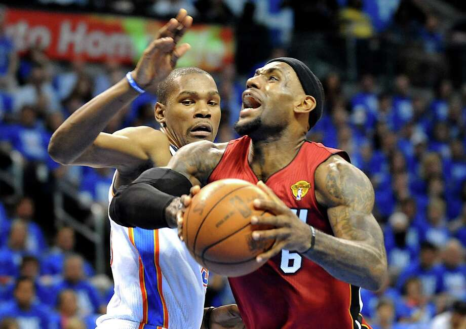 The NBA's Christmas Day lineup is highlighted by a Finals rematch between Kevin Durant's Oklahoma City Thunder and LeBron James' Miami Heat. Photo: Robert Duyos, MBR / Sun Sentinel