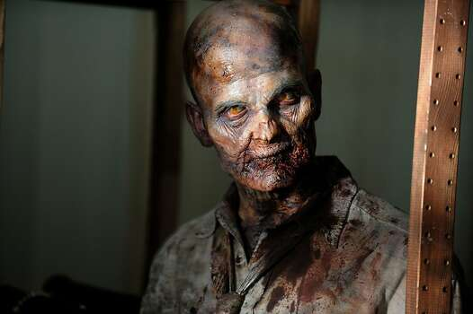 "This undated publicity photo provided by AMC shows a zombie in a scene from AMC's TV show, ""The Walking Dead."" Photo: Gene Page, Associated Press"