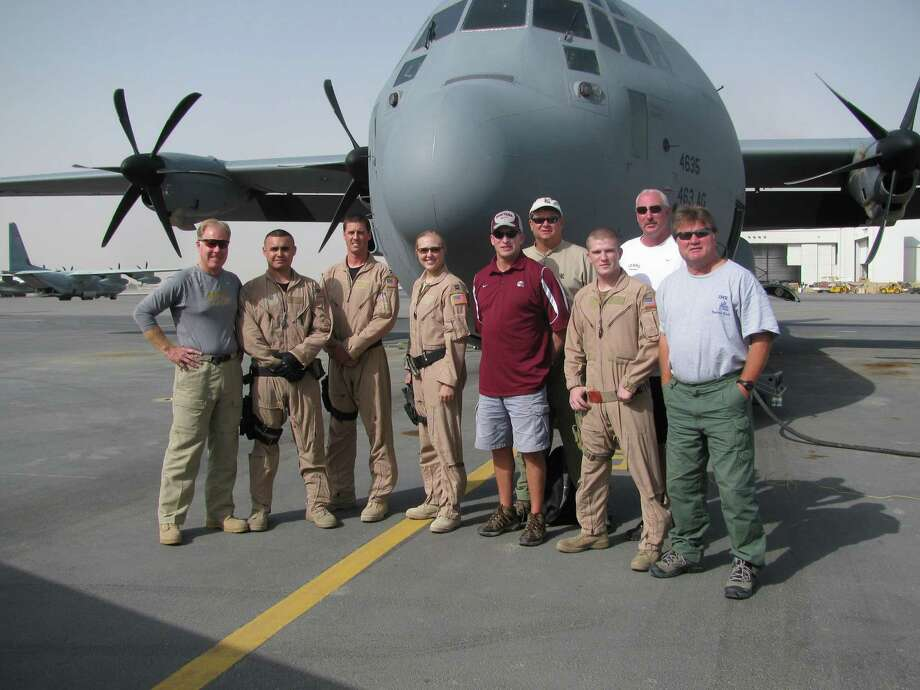 Rice football coach David Bailiff (fourth from right) poses with some of the servicemen and women he met while on a nine-day goodwill tour with the U.S. Army in Afghanistan in 2009. / handout