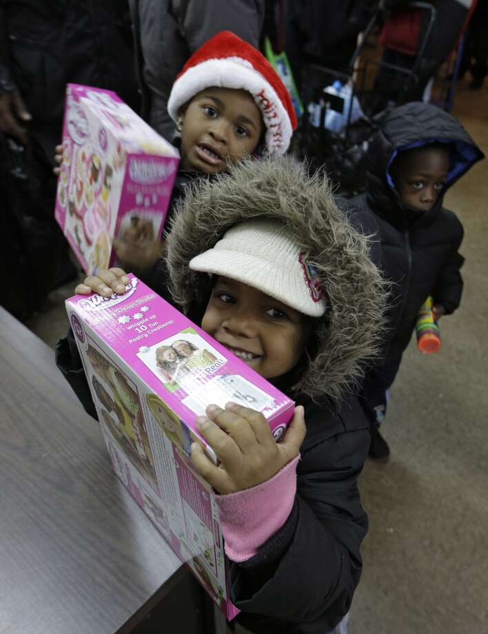 Malaya Turner,  5,  above,  and Kimora Jimenez,  4,  below,  show off donated toys they received from volunteers in New York.