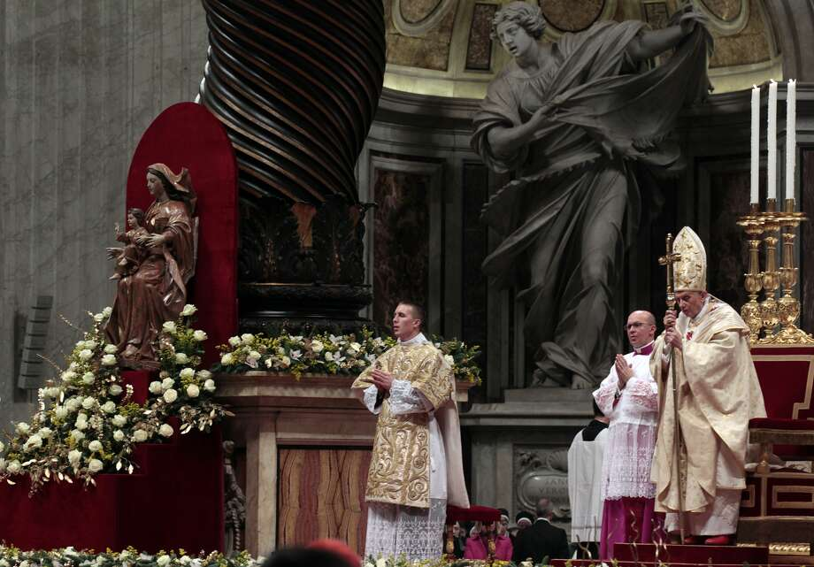 Pope Benedict XVI celebrates the Christmas Eve Mass in St. Peter's Basilica at the Vatican.