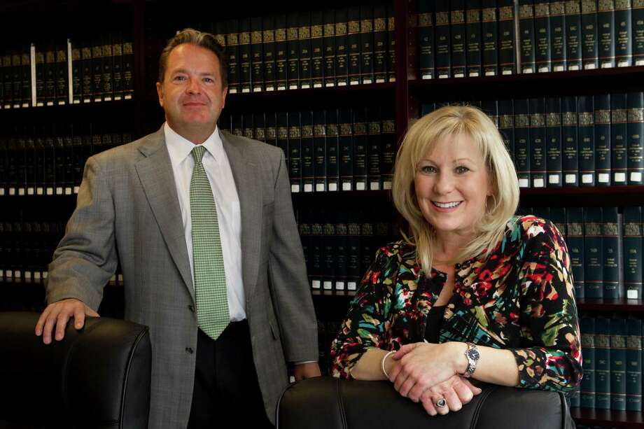 Ted Meyer, left, managing partner, Beth Harrington, an accounting manager, and their colleagues at Meyer Moser Lang will not have to pay premiums for family health insurance. Photo: Brett Coomer, Houston Chronicle / © 2012 Houston Chronicle