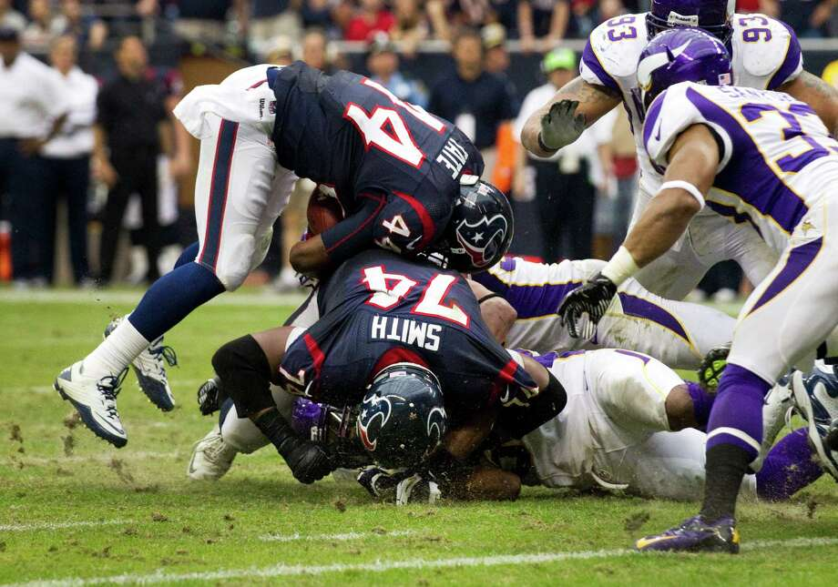 This stuffing of Ben Tate (44) at the Vikings' 1-yard line exemplifies the problems the Texans' offensive line has been having late in the season. Among the concerns: 10 sacks allowed over the final three games. Photo: Brett Coomer, Staff / © 2012  Houston Chronicle