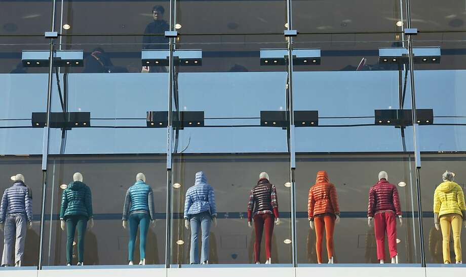 A man looks outside from the upper floor of a retail store as mannequins are displayed below,  in Tokyo, Monday, Dec. 24, 2012.  (AP Photo/Koji Sasahara) Photo: Koji Sasahara, Associated Press