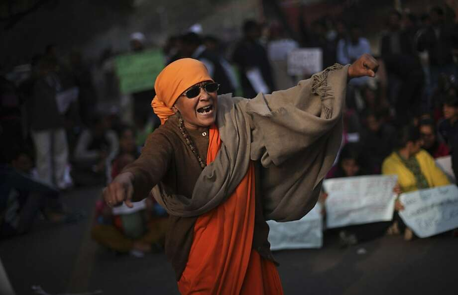 An Indian woman shouts slogans during a demonstration against the brutal gang-rape of a woman on a moving bus New Delhi, India, Monday, Dec. 24, 2012.  Authorities shut down roads in the heart of India's capital on Monday to put an end to a week-long demonstrations against the gang rape. (AP Photo/Altaf Qadri) Photo: Altaf Qadri, Associated Press