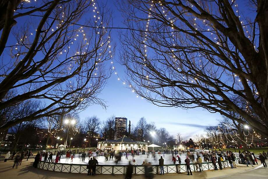 People skate on an ice rink on Boston Common in Boston,  on Christmas Eve, Monday, Dec. 24, 2012. (AP Photo/Michael Dwyer) STAND ALONE PHOTO Photo: Michael Dwyer, Associated Press